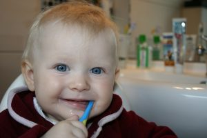 baby brushing teeth at new westminster dentist